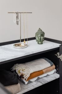 Kaboompics - Jewellery stand on marble shelf