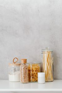 Kaboompics - Farfalle, spaghetti pasta in jars, wheat flour and chickpeas