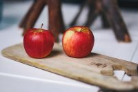 Red apples on a wooden board