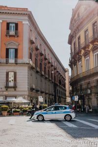 A police police car on the street in Naples