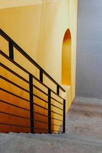 Kaboompics - Staircase by a yellow wall
