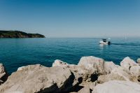 View from the rocky coast at the Adriatic Sea in the town of Izola, Slovenia