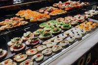 Kaboompics - Sliced bread topped with a variety of appetizers. Spanish Tapas