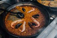 Top view of typical spanish seafood paella in traditional pan
