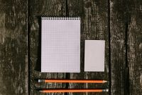 Kaboompics - White notepad with pencils on a wooden background