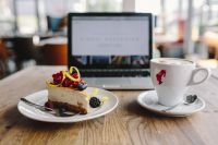 Kaboompics - Working in a restaurant: Macbook, Cheese Cake and Cup of Coffee