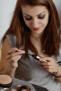 Kaboompics - Young beautiful woman doing her make up - eyelashes, black mascara