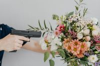 Kaboompics - A bouquet of flowers and a gun