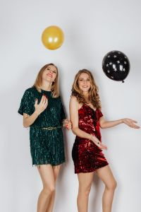 Kaboompics - Women Celebrate on a white Background with Balloons