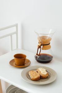 Coffee brewed in a Chemex and peanut butter sandwiches for breakfast