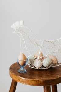 Kaboompics - Hen - shaped egg basket & glass egg holder