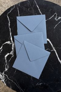 Kaboompics - Blue envelopes on marble