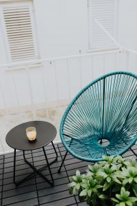 Kaboompics - A stylish garden chair and a small table on the balcony