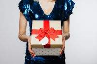Woman in Blue Dress Holds a Gift