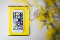 White smartphone with yellow flowers