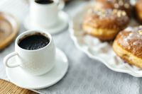 A cup of Coffee with Homemade Donuts