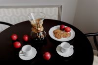 Kaboompics - Breakfast served with coffee, cookies and plums