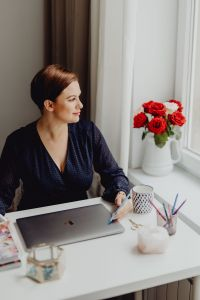 Kaboompics - Happy casual beautiful woman working on a laptop