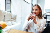 Kaboompics - Beautiful woman having coffee at cafe