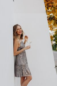 Kaboompics - Blond Woman in a Sequin Dress is Holding a Glass of Champagne