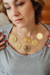 Kaboompics - The woman holds a Cryptocurrency Bitcoinf