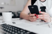 Kaboompics - Businesswoman uses her mobile phone at her desk