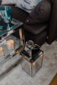 Kaboompics - Candles and silver lantern on a carpet