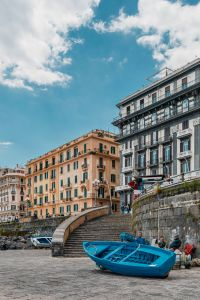 Old buildings - architecture of Naples & blue fishing boat