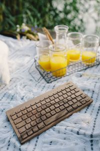 Kaboompics - Wooden keyboard on the white blanket