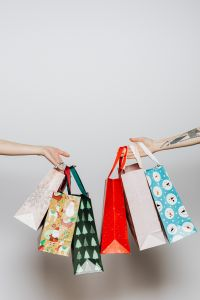Kaboompics - Hands holding gift bags