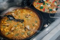 Top view of typical spanish chicken paella in traditional pan