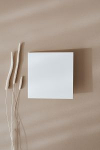Kaboompics - Blank card & dried grass on beige background