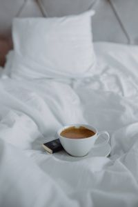Morning coffee with chocolate in bed