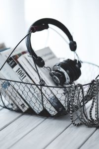 Kaboompics - Headphones with a basket of books