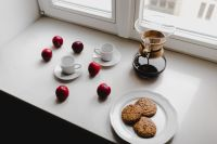 Kaboompics - Delicious morning freshly brewed filter coffee with cookies and plum fruits