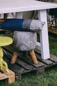 Kaboompics - Grey stool with a pillow by a table