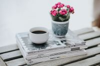 Kaboompics - Little pink flowers with a coffee and a stack of magazines