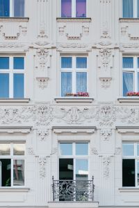 The facade of an old ornamental tenement house at Piotrkowska Street in Łódź, Poland