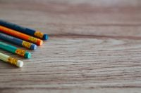 Kaboompics - Colourful pencils with rubber erasers on a wooden desk