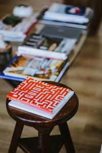 Kaboompics - Magazines on a table and stool