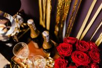 Kaboompics - New Year's Eve party - bottle of champagne, glasses & red roses