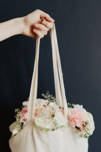 Kaboompics - Bouquet of flowers in a bag with some fairy lights