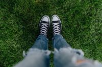 Woman, jeans, sneakers, green grass