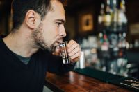 Kaboompics - Handsome young man drinking vodka at the bar