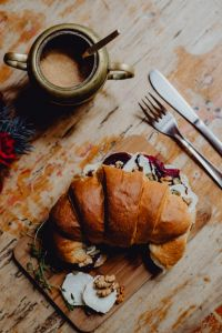 Kaboompics - Croissant with goat cheese, beetroot and a cup of coffee for breakfast