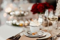Kaboompics - Coffee with whipped cream in a porcelain cup on a Christmas table