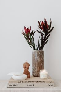 Kaboompics - LEUCADENDRON SAFARI SUNSET - candle - marble vase - alabaster - jewelry - gold earrings