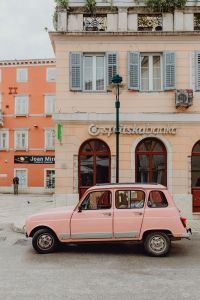 Pink Renault 4 on the street in the city of Rovinj, Croatia
