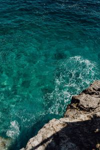 Beautiful turquoise water crashing into rocks
