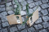 Kaboompics - Miniature green plants in a small glass on cobblestone